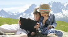 Two boys in Alps with touchpad